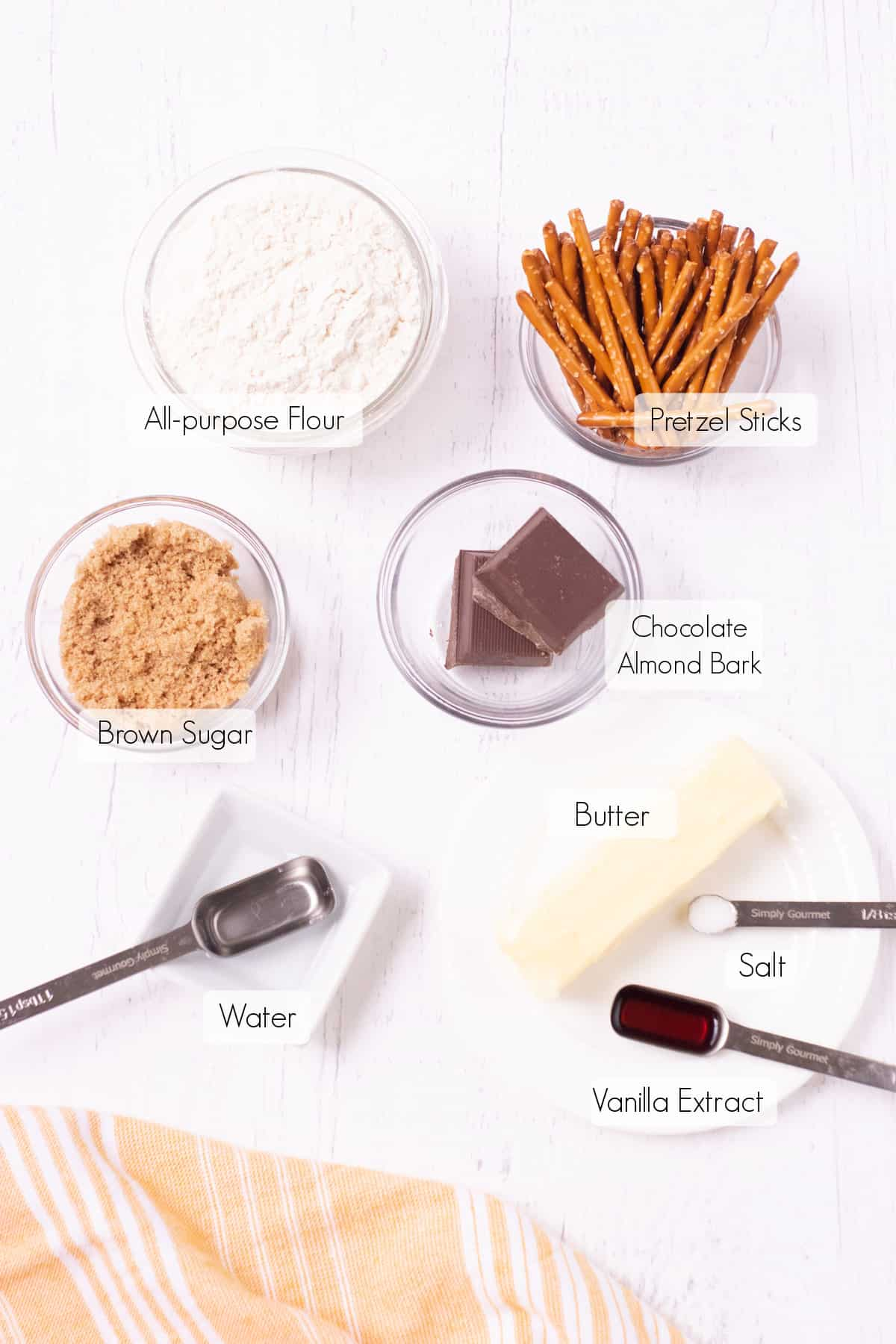 Labeled ingredients to make witches broom cookies.