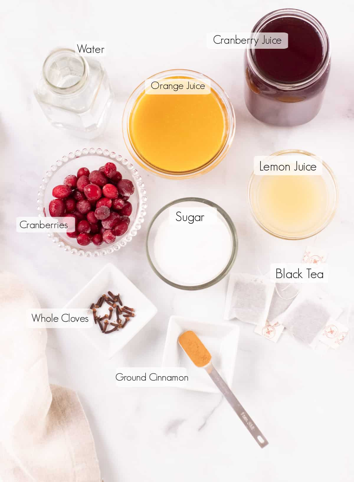 Labeled ingredients to make orange cranberry tea concentrate.