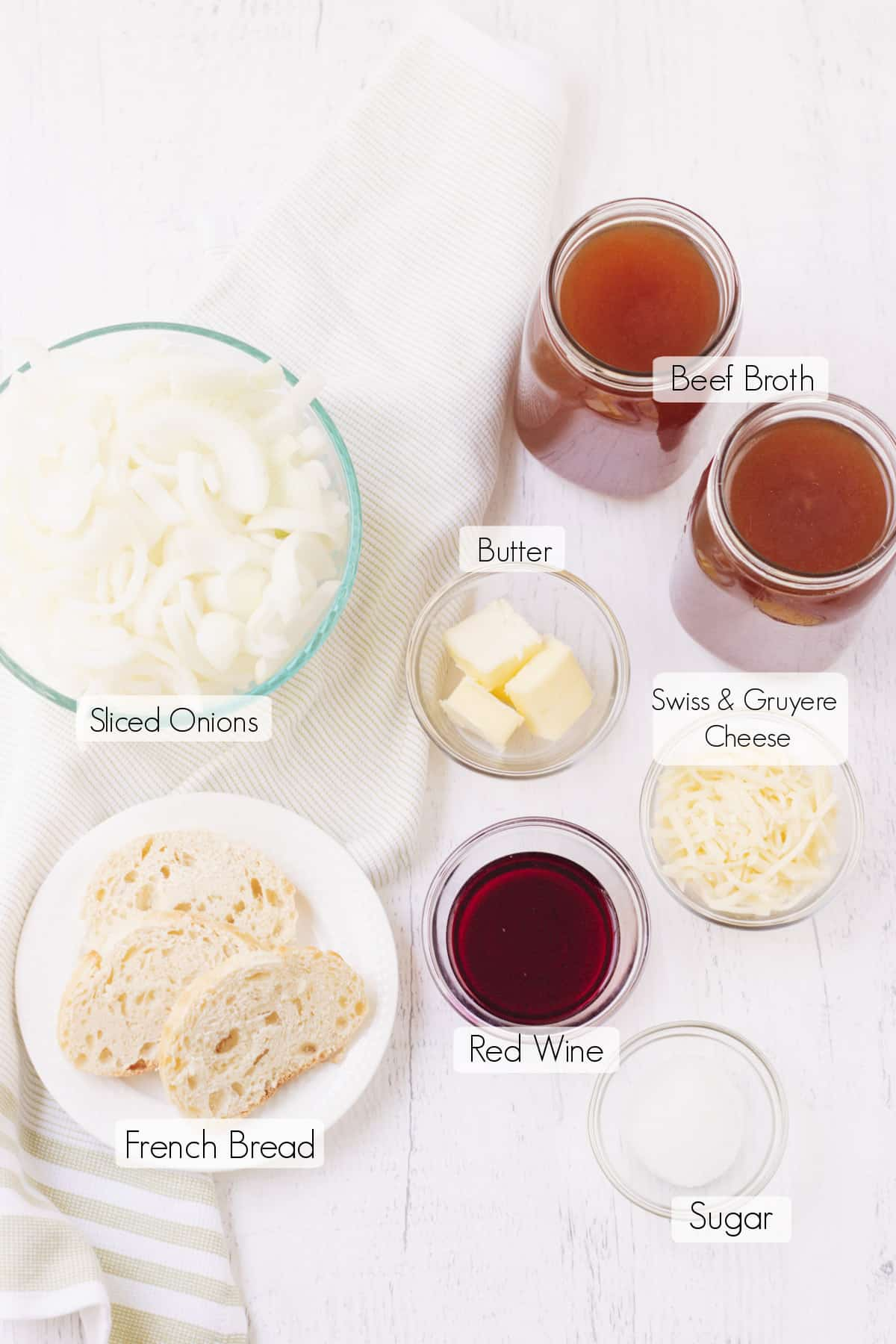 Labeled ingredients to make easy Crock Pot French onion soup.