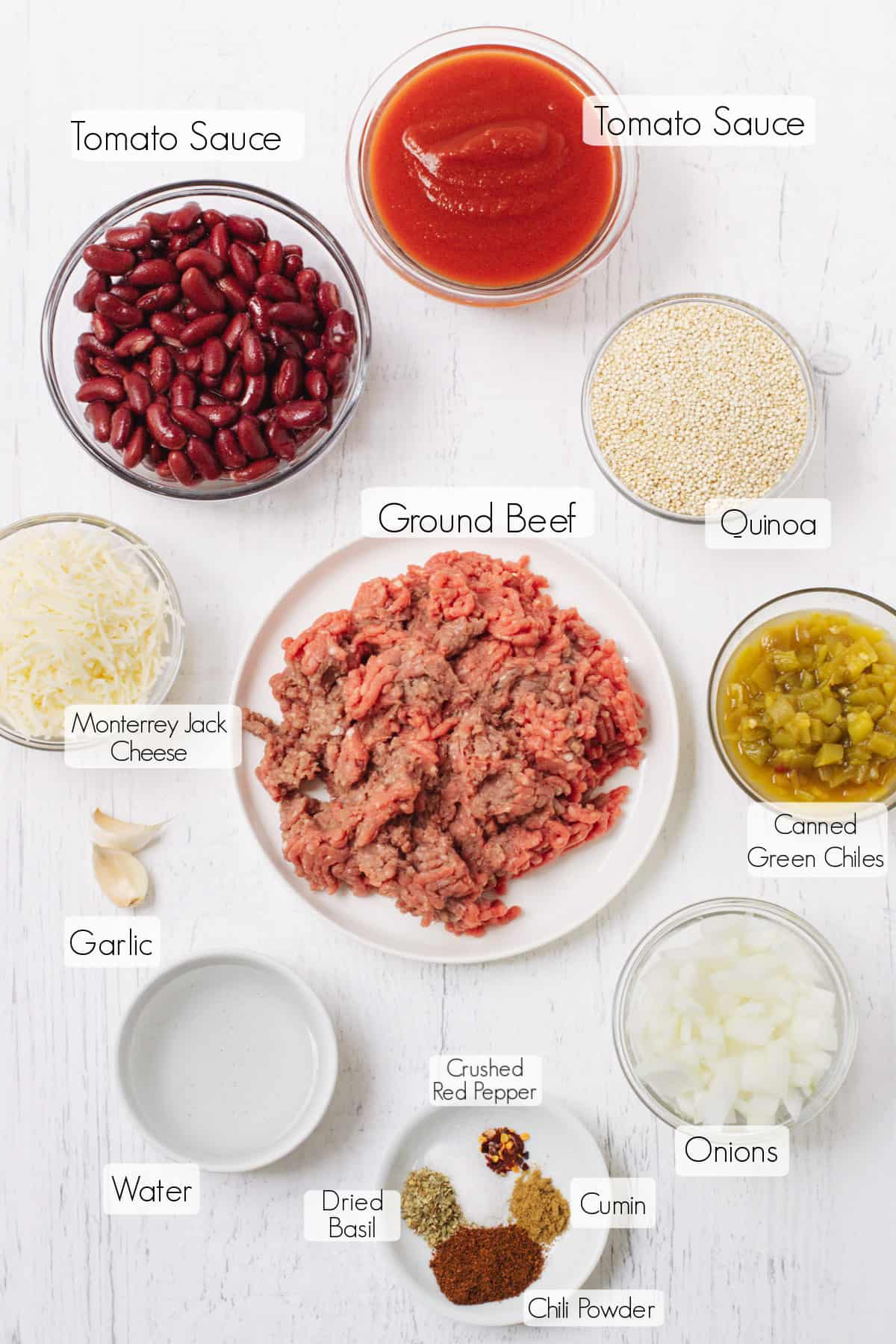 Labeled bowls of ingredients to make ground beef and taco quinoa skillet meal.