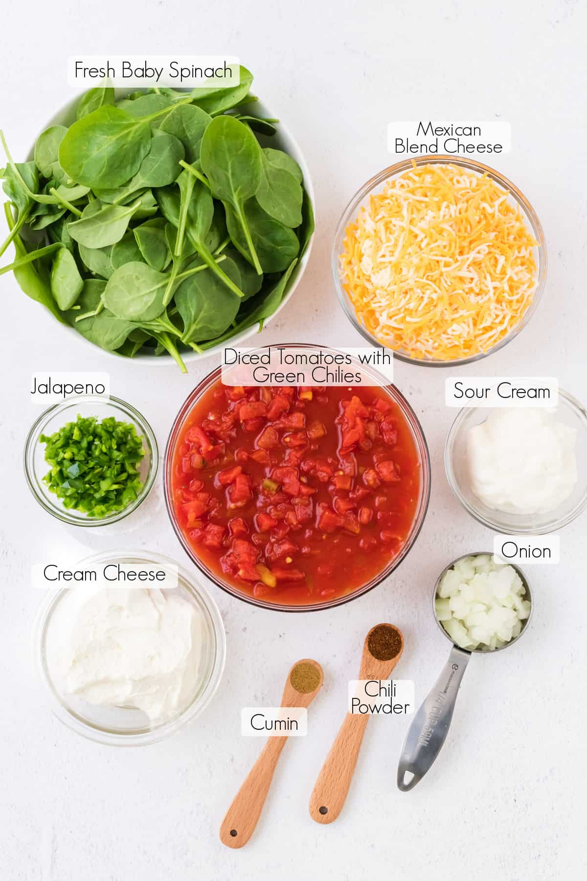Labeled ingredients to make spinach queso dip.