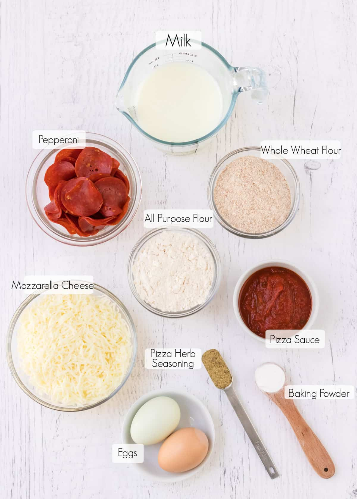 Labeled ingredients to make mini pepperoni pizza muffins.