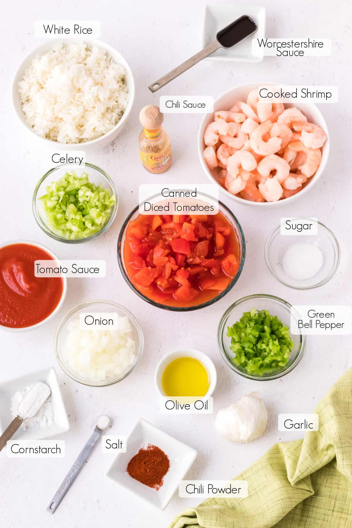 Labeled ingredients to make easy shrimp creole sauce recipe.